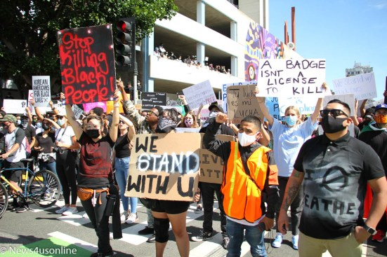 Marching in solidarity: Black Lives Matter (Los Angeles) holds a march and rally in downtown Long Beach, California on Sunday, May, 31, 2020. The protest was held to bring attention to police violence in the wake of the death of George Floyd, who died in police custody. Thousands of demonstrators showed up for the event. Photo credit: Dennis J. Freeman/News4usonline