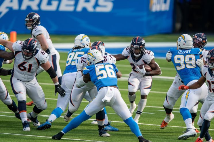 Denver Broncos running back Melvin Gordon III gains yards against the Los Angeles Chargers