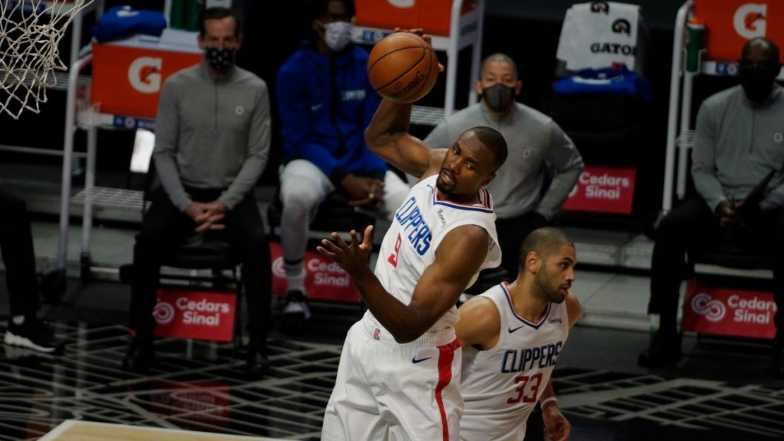 Center Serge Ibaka has been a welcming presence for the Los Angeles Clippers thus far this season. Ibaka grabs a rebound during the Clippers' 124-101 win against the Minnesota Timberwolves on Wednesday, Dec. 29, 2020. Photo by Melinda Meijer for News4usonline