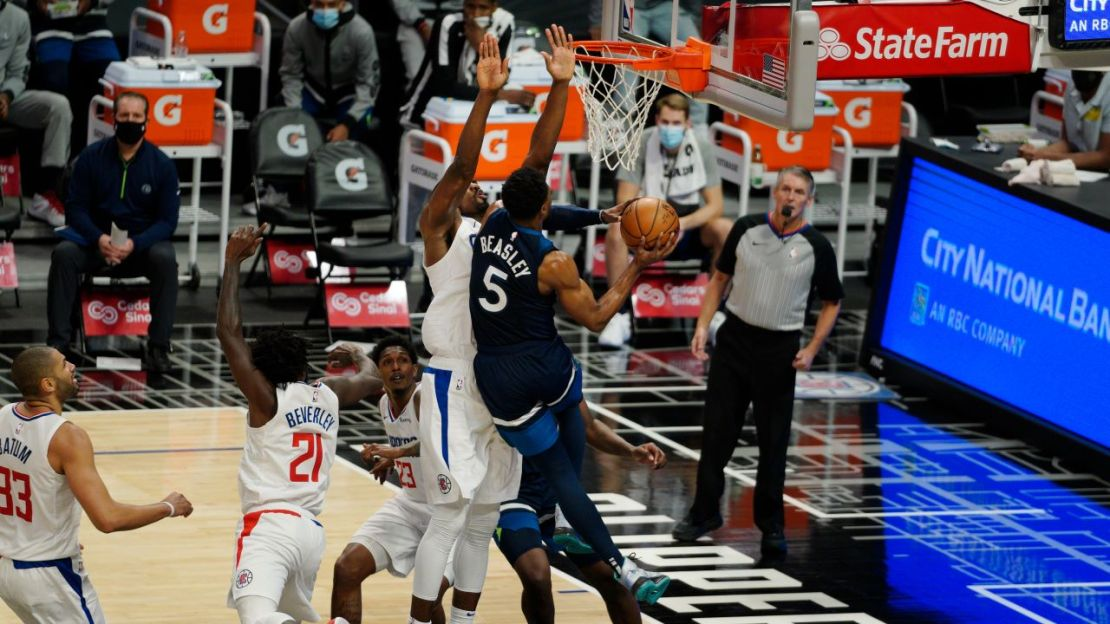 Los Angeles Clippers center Serge Ibaka (9) goes for the blocked shot against Minnesota Timberwolves star Malik Beasley (5) on Wednesday, Dec. 29, 2020. The Clippers defeated the Timberwolves, 124-101, at STAPLES Center. Photo by Melinda Meijer for News4usonline