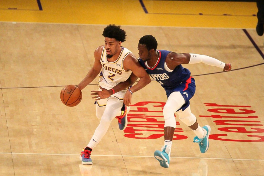 Los Angeles Lakers guard Quinn Cook (2) dribbles past Reggie Jackson of the Los Angeles Clippers in the two teams first preseason game. Courtesy photo