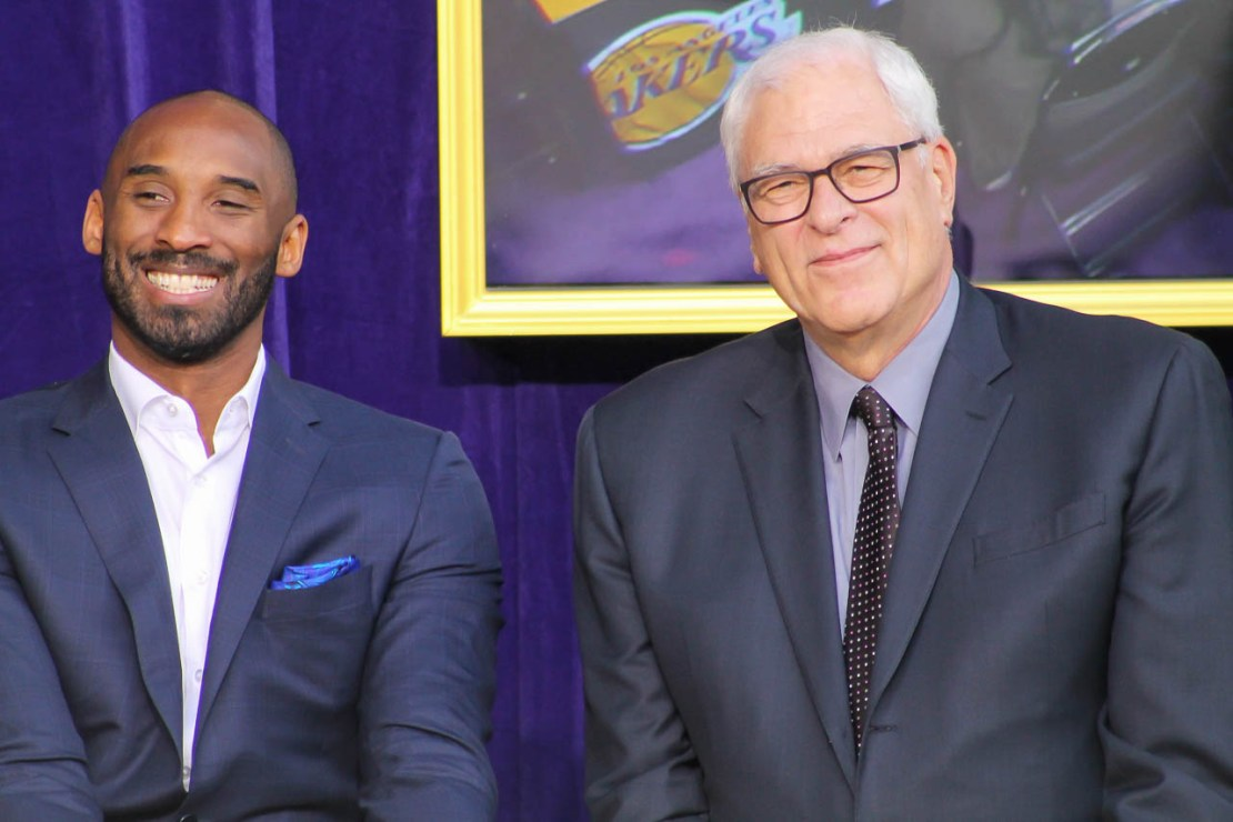 Hall of Famer and Los Angeles Lakers great Kobe Bryant with his former coach Phil Jackson at Shaquille O'Neal's statute ceremony in front of STAPLES Center in 2017. Photo credit: Dennis J. Freeman/News4usonline