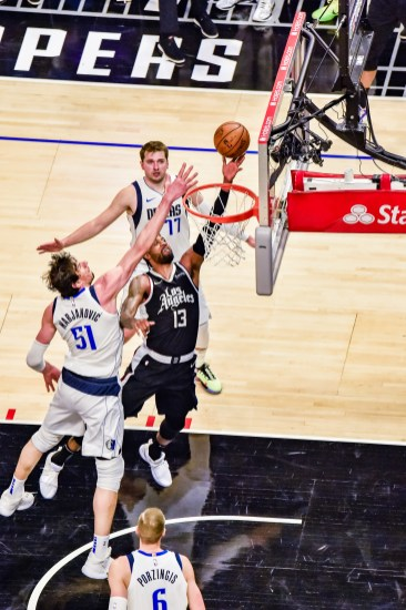 June 6, 2021-Paul George (13) drives to the basket. Photo credit: Mark Hammond/News4usonline