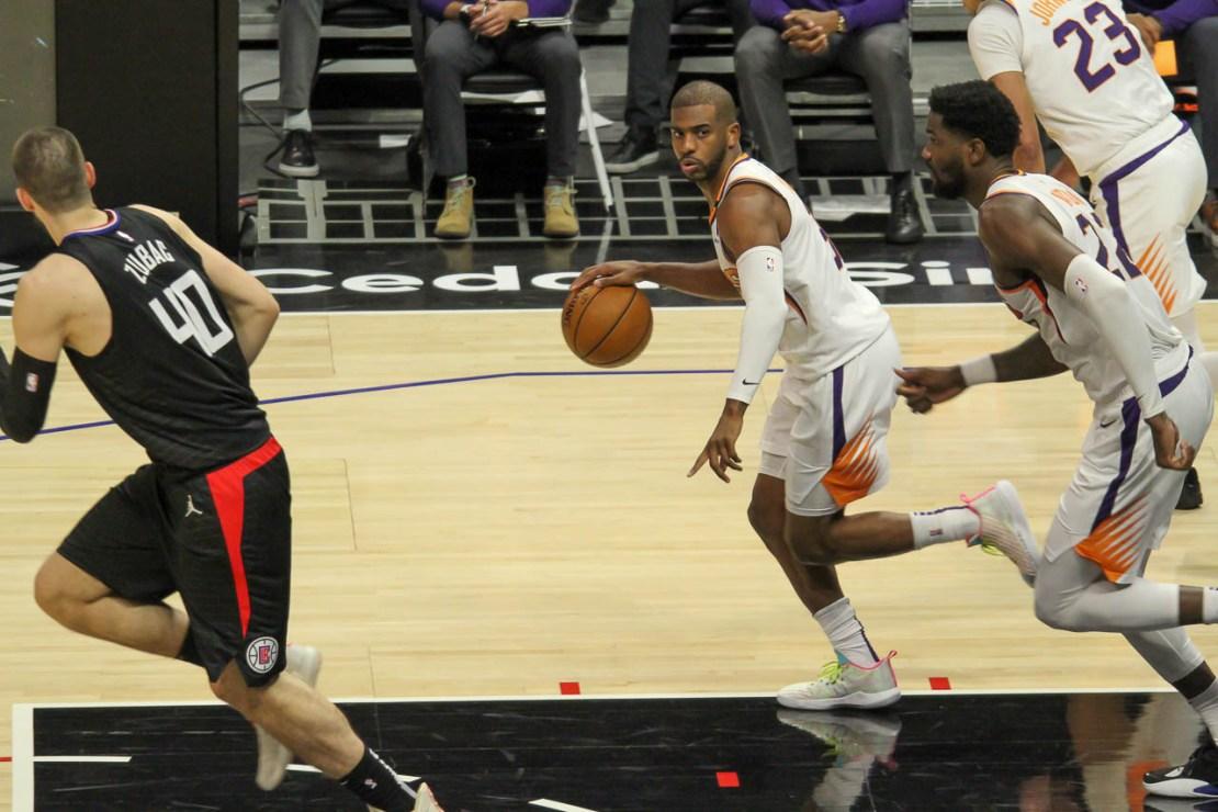 April 8, 2021-Phoenix Suns guard Chris Paul leads the fastbreak against the Los Angeles Clippers at STAPLES Center. Photo by Dennis J. Freeman/News4usonline