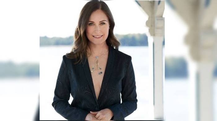 Finland PM Sanna Marin trolled for wearing low-cut blazer; others support by sharing identical pics