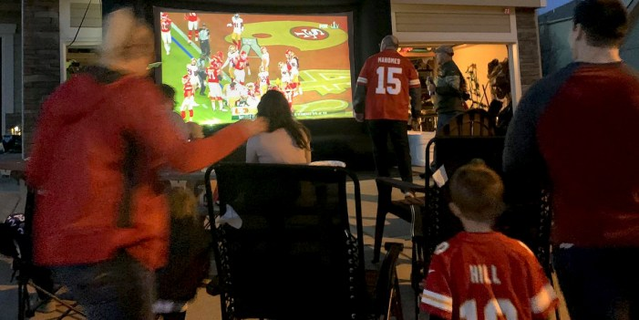 Football fans turn to outdoor projectors for Super Bowl watch parties