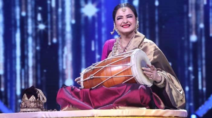 Rekha looks stunning in a golden Kanjivaram sari as she gives Neha Kakkar 'shaadi ka shagun'
