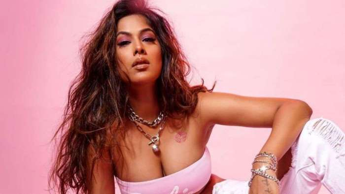 Nia Sharma looks smoking HOT in Barbie tube top with kiss imprint on her chest