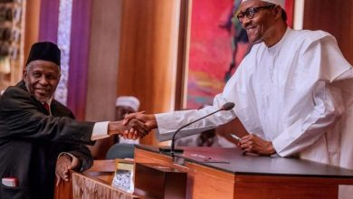 Photo of BREAKING: Buhari swears in Muhammad as CJN