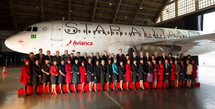 Star Alliance CEOs and top executives, along with uniformed staff members welcome Avianca Brasil to the Star Alliance family