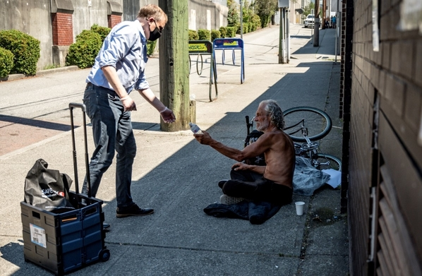 Yesterday,  I handed out over 200 cold bottles of water to seniors, the unhoused and those in need to help