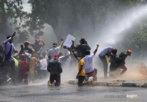 ENDSARS protesters being watered and teargassed