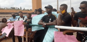 Adebisi in black shirt and faz cap flanked by other Protesters in Osogbo