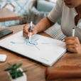 Design and productivity product HustleCase is a laptop case with built-in whiteboard to help users share their ideas, sketch on-the-go, and communicate better.