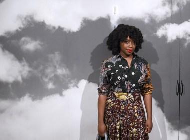Nigerian writer Chimamanda Adichie poses prior to the start of the Christian Dior Women's Fall-Winter