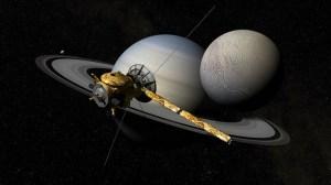 De sonde Cassini boven Enceladus en Saturnus. Afbeelding: Kevin Gill