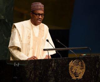 •President Buhari reading a speech