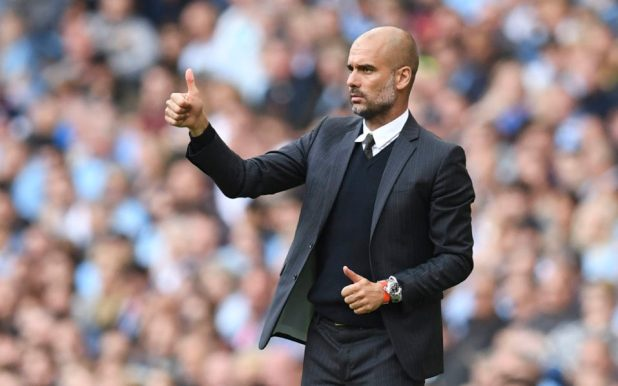 Manchester City's Spanish manager Pep Guardiola gives a thumbs up from the touchline during the English Premier League football match between Manchester City and Bournemouth at the Etihad Stadium in Manchester, north west England, on September 17, 2016. / AFP PHOTO / PAUL ELLIS / RESTRICTED TO EDITORIAL USE. No use with unauthorized audio, video, data, fixture lists, club/league logos or 'live' services. Online in-match use limited to 75 images, no video emulation. No use in betting, games or single club/league/player publications.  /