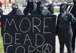 more dead cops is ANTIFA a political party are ANTIFA violent riot protestors