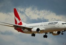 Qantas says it has been hurt by rules limiting foreign ownership of the airline to just 35%