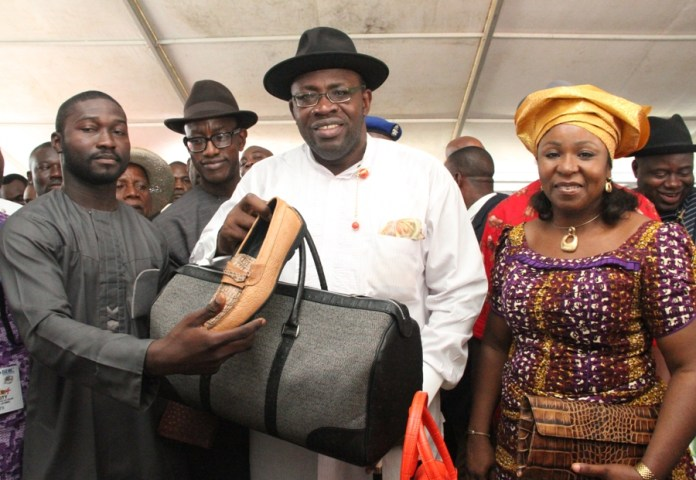 Governor Seriake Dickson of Bayelsa State (2nd R), and an exhibitor, Pere Lei (L), displaying ?Made in Bayelsa? products, while the Commissioner for Trade, Industry & Investment, Hon. Kemela Okara (2nd L), and the Chief of Staff, Government House, Yenagoa, Dame Didi Walson-Jack (R), looks on with delight, during an exhibition by local and International entrepreneurs, as part of activities in the ongoing 20th International Conference on Small & Medium Enterprises (ICSME), at the Banquet hall, Government House, Yenagoa.