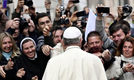 Pope Francis greets the crowd as he leaves a mass for the Polish community in Rome on Sunday. Photograph: Alessandro Bianchi/Reuters