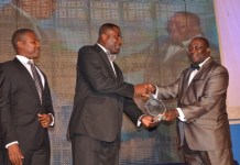 MR FRANKLIN SOWAH AND MR. ABDUL-MAJEED RUFAI RECEIVING THE SECOND AWARD AT CIMG AWARDS