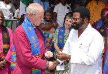 Dr Vanderpuije presenting the keys of the city of Accra to the Archbishop in honour of his visit