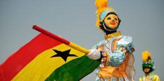 A particpant waves the Ghana flag during the Winneba Masquerade Festival in Winneba, Ghana on New Year's Day 2010.