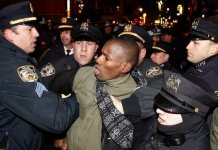 Police make an arrest at a protest in Midtown, New York, early on Friday