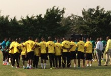 Black Stars players in a huddle.