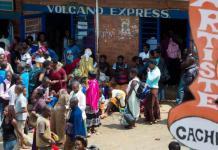 Passengers stranded in Nyabugogo bus terminal yesterday waiting for omnibuses . (T.Kisambira)
