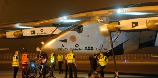 Crew members gather to push the Solar Impulse 2 (Si2) towards a hangar after it landed at an airport in the western Indian city of Ahmadabad, March 11, 2015. A solar powered aircraft, Si2 which is on a global flight, landed in the western Indian city of Ahmadabad before Tuesday night, said TV channel NDTV. (Xinhua/Stringer)