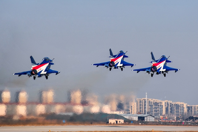 J-10 jet fighters of the Bayi Aerobatic Team of the Air Force of the Chinese People's Liberation Army take off at an airbase, March 10, 2015. Pilots Yu Xu, Tao Jiali, Sheng Yifei and He Xiaoli, members of the People's Liberation Army (PLA) Air Force acrobatic team, left for Malaysia Wednesday to perform at the Langkawi International Maritime & Aerospace Exhibition (LIMA) in the J-10 fighter jets. Their stunt show will be the first time China's female fighter pilots have performed abroad. (Xinhua/Zhang Pengyan) (mt)
