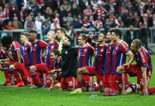 Bayern Munich's players celebrate after their UEFA Champions League quarterfinal match against FC Porto in Munich, Germany, on April 21, 2015. Bayern Munich won 6-1 and advanced to the semifinals with 7-4 on aggregate. (Xinhua/Philippe Ruiz)