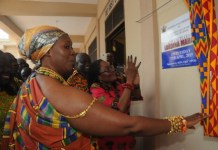First Lady Lordina Mahama unveils a plaque after commissioning the hostel named after her at the Presby Midwifery Training School, Dormaa