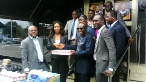 MD of McOttley Capital, Mrs. Happy Forson, presenting the items to Lawyer Tweneboah Kodua of UTV.