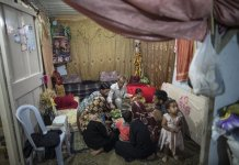 "Palestinians are seen inside their temporary house ""caravan"" in the southern Gaza Strip city of Khan Younis on July 7, 2015. The 50-day war between Israel and Gaza Hamas-led militant groups ended after Egypt brokered a truce between the two sides. However, people in the coastal enclave still live amid poverty, unemployment and the ongoing endless Israeli blockade. (Xinhua/Wissam Nassar)"