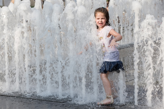 A girl plays at a fountain during the summer heat in Budapest, Hungary on July 7, 2015. (Xinhua/Attila Volgyi)