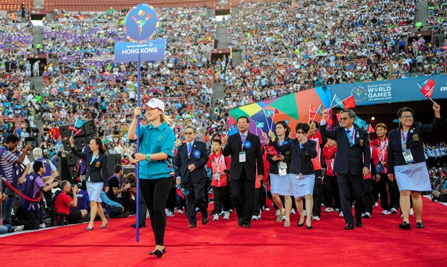 Chinese Hong Kong Delegation march into the Memorial Coliseum, during the Opening Ceremony of the Special Olympics World Games in Los Angeles, the United States, July 25, 2015. The 2015 Special Olympics World Games gathers over 6,500 athletes from 165 countries and regions, taking part in 25 events, and lasts from July 25 to August 2.(Xinhua/Zhang Chaoqun)