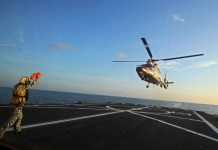 """A Dolphin Z-9 helicopter of China's Navy missile frigate CNS Yulin flies off the deck of Singapore's Navy missile frigate RSS Intrepid during the """"Exercise Maritime Cooperation 2015"""", May 25, 2015. The Singapore and Chinese navies concluded the inaugural Exercise Maritime Cooperation 2015 on May 25. (Xinhua/Then Chih Wey)"""