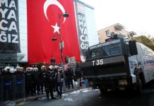 Police maintain the order in front of the building of a media group in Istanbul, Turkey, on Oct. 28, 2015. Turkish police on Wednesday used tear gas and water cannon to storm the headquarters of the media group known for its opposition to the government. (Xinhua/Cihan)