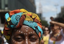 A woman takes part in the celebrations of the Black Consciousness Day in Sao Paulo, Brazil, on Nov. 20, 2015. The Black Consciousness Day is celebrated annually in cities across Brazil in honor of the country's 17th-century anti-slavery leader Zumbi dos Palmares. (Xinhua/Rahel Patrasso)