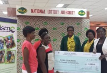 Mrs Maame Kesewa Dolphin, Corporate Communications Manager of NLA presenting the dummy cheque to the Trustee of the Foundation, Madam Cynthia Mawusi Boadi.