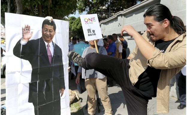 Anti-Beijing protesters have held protests in Taipei against the meeting...