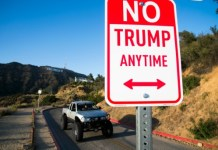 """AFP/File / Robyn Beck A sign reading """"No Trump Anytime"""" on April 27, 2016 in the hills above Hollywood, California"""