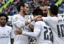 Real Madrid's midfielder Isco (C) is congratulated by Real Madrid's Welsh forward Gareth Bale (2nd L) and Real Madrid's French forward Karim Benzema (2nd R) after scoring a goal during the Spanish league football match Getafe CF vs Real Madrid CF at the Coliseum Alfonso Perez stadium in Getafe on April 16, 2016. / AFP / GERARD JULIEN (Photo credit should read GERARD JULIEN/AFP/Getty Images)