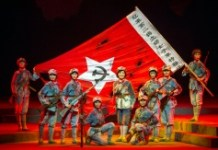 """AFP / STR Performers dancing and singing during a Chinese national opera of the """"Red Detachment of Women"""" in Haikou, south China's Hainan province"""