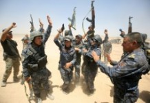 AFP/File / Ahmad Al-Rubaye Pro-government fighters celebrate in the al-Sejar village, in Iraq's Anbar province, on May 27, 2016, as they take part in a major assault to retake Fallujah
