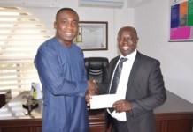 Mr Adu-Sarkodie presenting the cheque